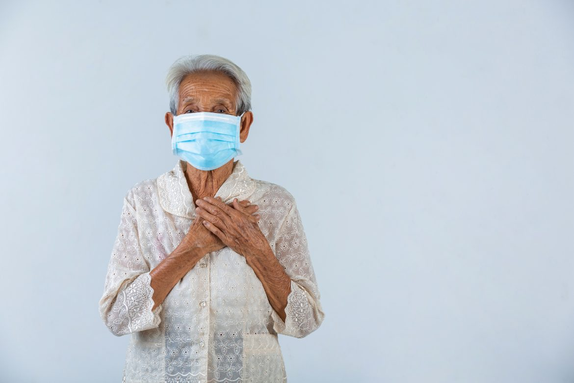 grandmother-is-puting-her-hands-in-the-lock-and-hoped-for-the-best-cencept-mask-campaign.jpg