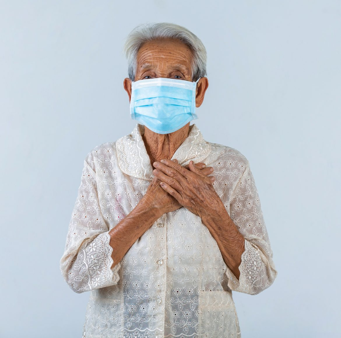 grandmother-is-puting-her-hands-in-the-lock-and-hoped-for-the-best-cencept-mask-campaign-2.jpg